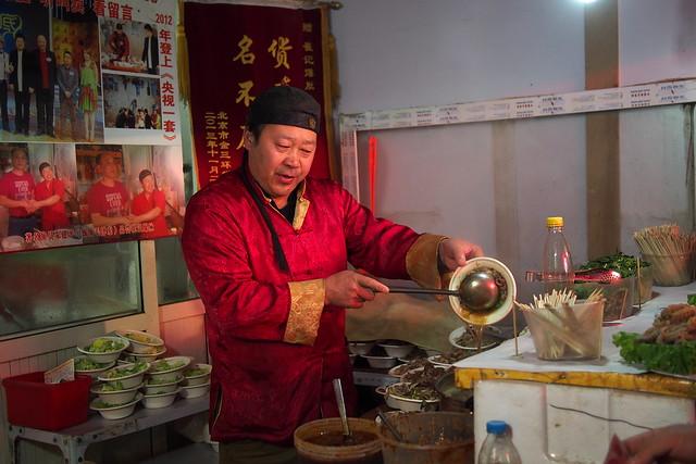 singing noodle hawker, 王府井夜市 (Wang Fu Jing Night Market), Beijing, China