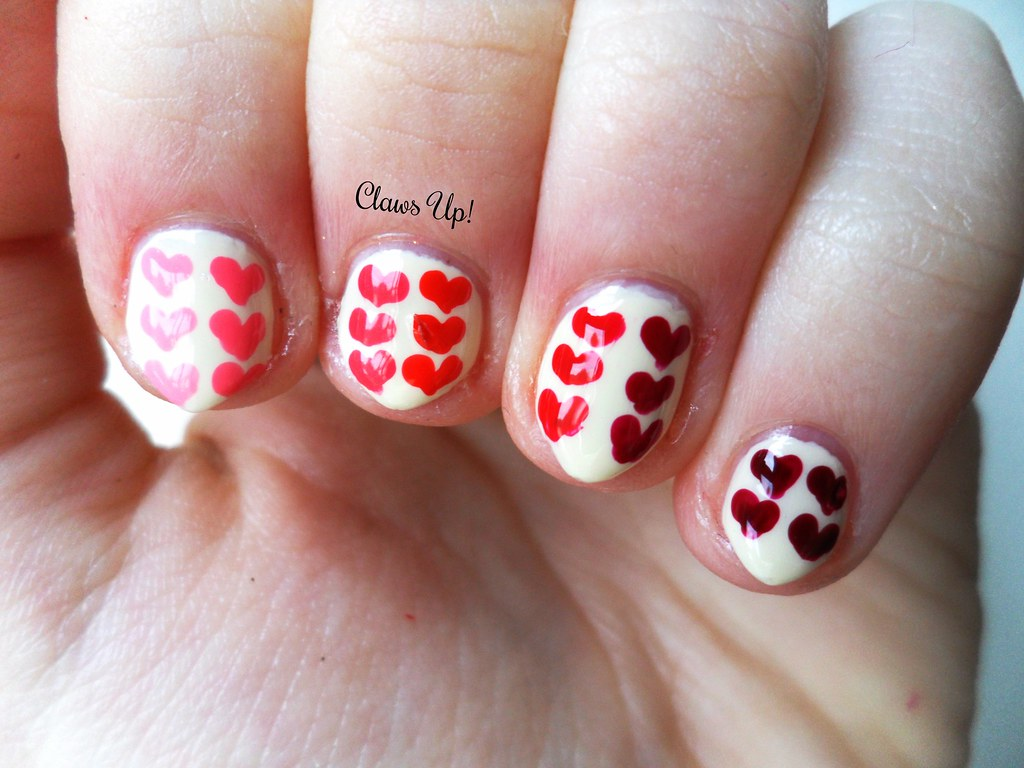 Pink to red ombre heart nail art for Valentine's day