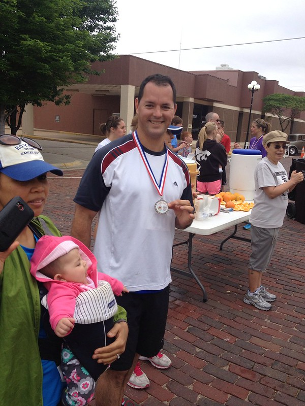 Adam displays his first place age group medal.