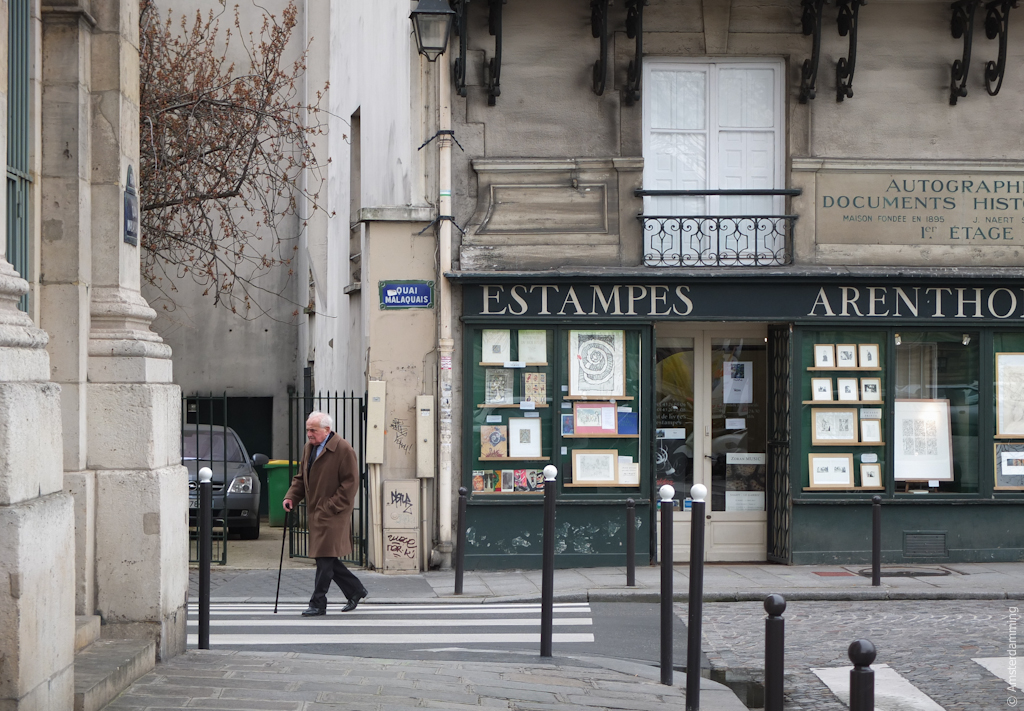 Paris, Old Man Walking on a Street near Seine