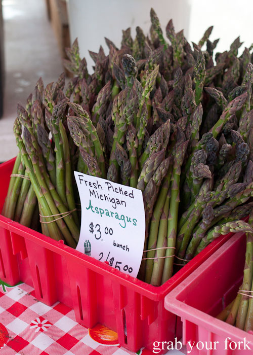 Fresh picked Michigan asparagus Logan Square Farmers Market greenmarket producers vegetables Chicago Illinois