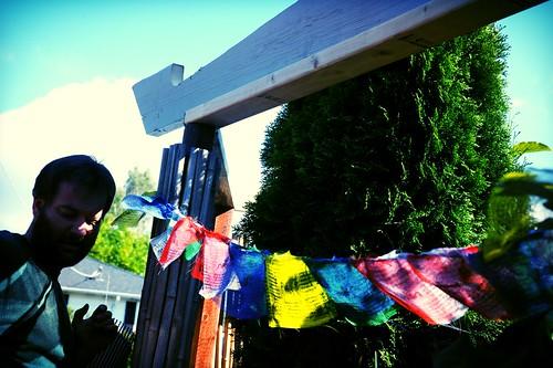 Installing decorative fence, Stephen Klineburger, Tibetan Prayer flags, tree, Seattle, Washington, USA by Wonderlane