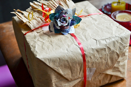 Magazine Paper Rose adorning a present