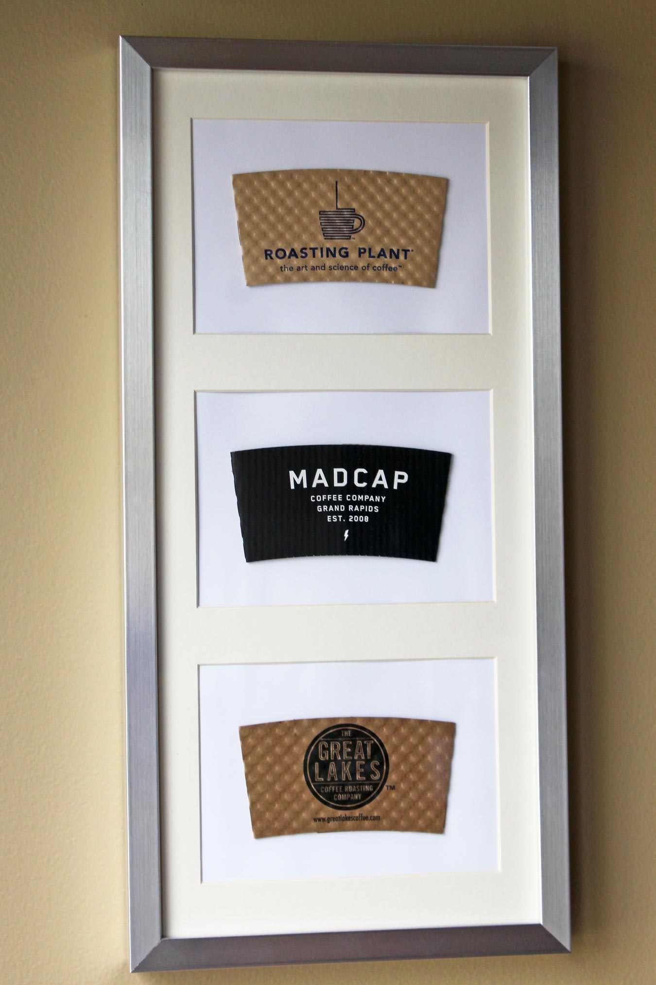 How To Repurpose Coffee Sleeves As Wall Art [via Wading in Big Shoes]
