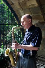 Saxophonist under bridge in Central Park