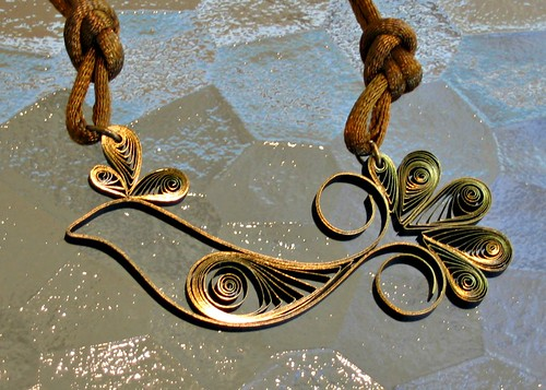 Quilled bird necklace on silk cording