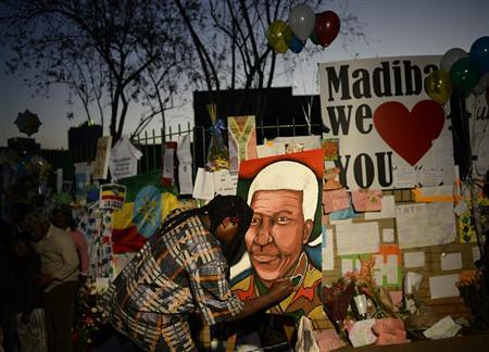 Well wishers have placed items in honor of former South African President Nelson Mandela. The 94-year-old has been hospitalized in Pretoria. by Pan-African News Wire File Photos