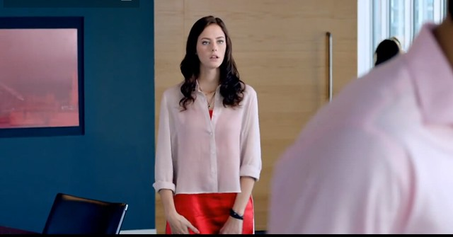 Effy, the lead character of Skins, standing in a professional office looking nervous