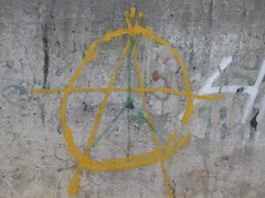 Anarchy sign painted on a wall