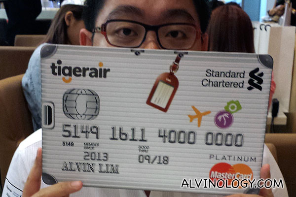Me with my new giant-size Standard Chartered Tigerair Platinum credit card