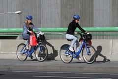 Tourists ride their hired bikes down LaTrobe Street towards Docklands