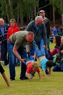 Nethy Bridge: Highland Games:Children'events: wheelbarrow race serie: Tenderness