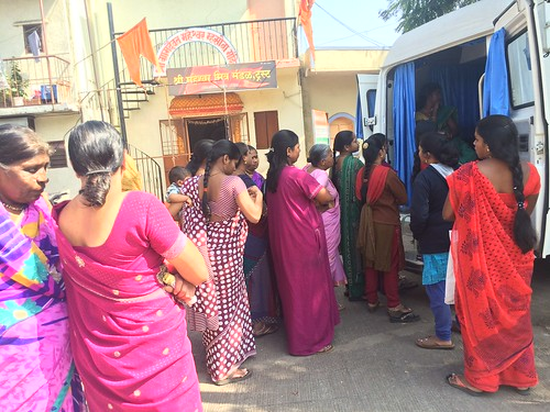At my internship site, women waiting to receive services from the Family Planning Association of India mobile van clinic