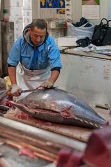 Tuna Dealer Cutting a Large Bluefin Tuna at Tsukij…