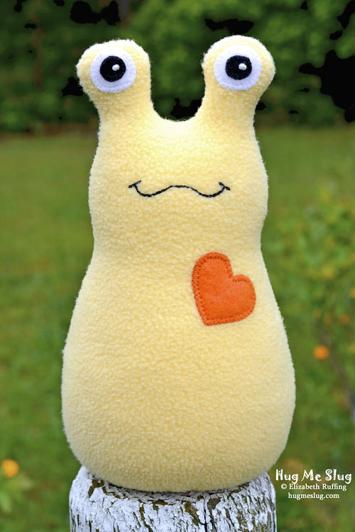 Banana yellow Fleece Hug Me Slug, original art toy by Elizabeth Ruffing