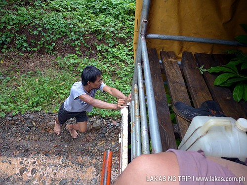Noli helping by pushing the truck go up the steep hill.