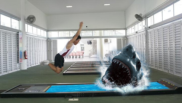 Because normal standing broad jump is too mainstream. Add some sharks.