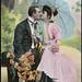 Kyssende par på benk