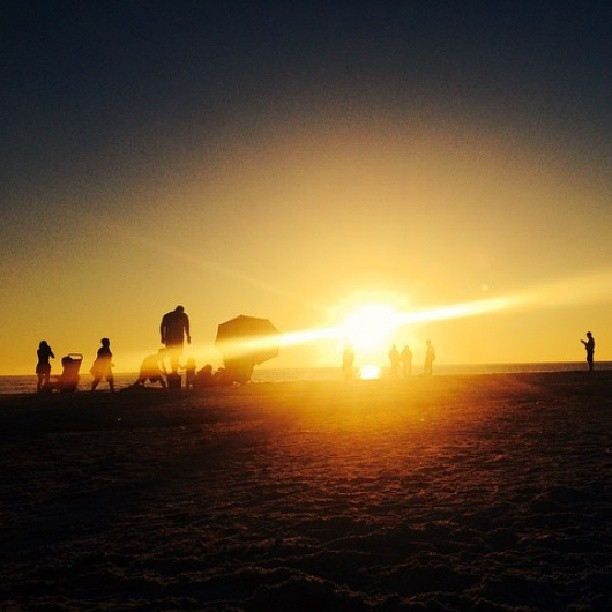 People behind us on the beach took this photo of our family and then offered to text it to us. #siestakey #sunset