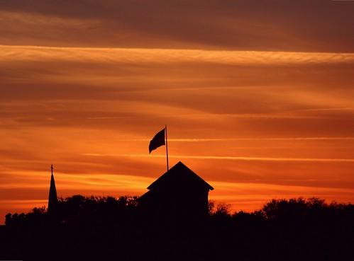 city roof sunset mist tower rooftop church silhouette downtown glow cross unitedstates florida flag americanflag treetops roofline northflorida orangeglow wavingflag beyondthehorizon saintaugustineflorida cloudlines