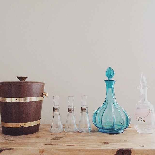 Today's vintage finds: wooden (walnut) ice bucket, three bitters decanters (Agnostura, Lemon, Orange), blue glass decanter, pink and floral decanter. All coming soon to the shop.  #vintage #vintagesoup #thrifted #thrifting #barware
