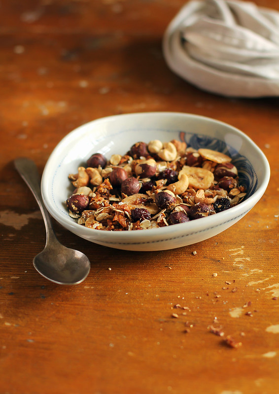 Homemade granola with dried cranberry, figs, banana chips, hazelnuts and cashew