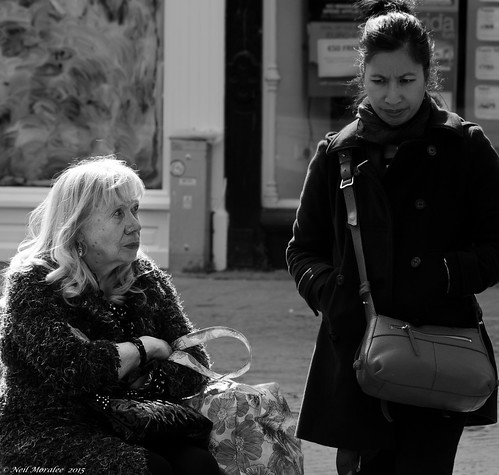 street old uk blackandwhite bw woman white black monochrome female bag mono fight nikon women candid neil somerset mature scowl bags tension racial taunton argue misunderstanding imigrant moralee d7000