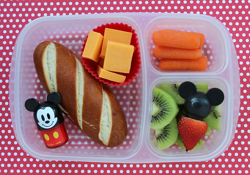 Mickey Mouse bento box school lunch - soft pretzel, carrots, fruit, furikake salt shaker