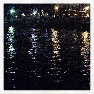 Lights reflecting on the water at night