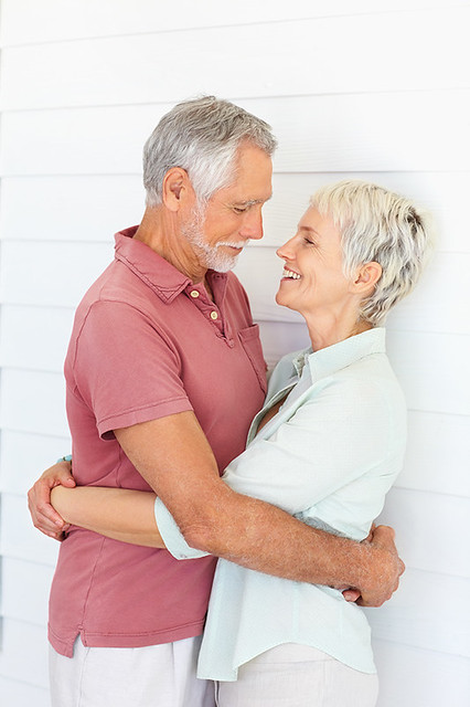 Happy elderly couple embracing eachother