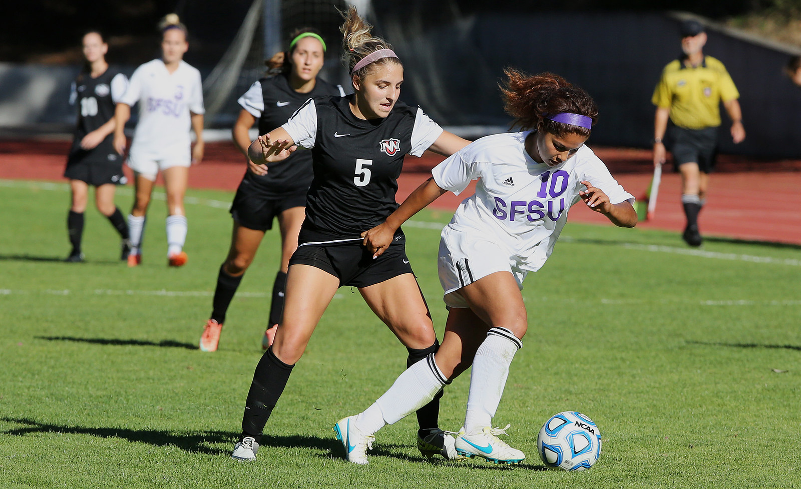 Mariela Holguin, right, defends the ball from Kelsey Martin during a game featuring the SF State Gators vs the Northwest Nazarene University Crusaders at Cox Stadium on Sept. 5. The Gators were able to secure a victory one minute into the first overtime, with the final score being 1-0. Photo by John Ornelas / Xpress