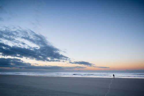 ocean sky usa sun man beach sc water clouds sunrise person us sand waves unitedstates unitedstatesofamerica southcarolina footprints places locations kiawahisland johnsisland ef2470f28lusm