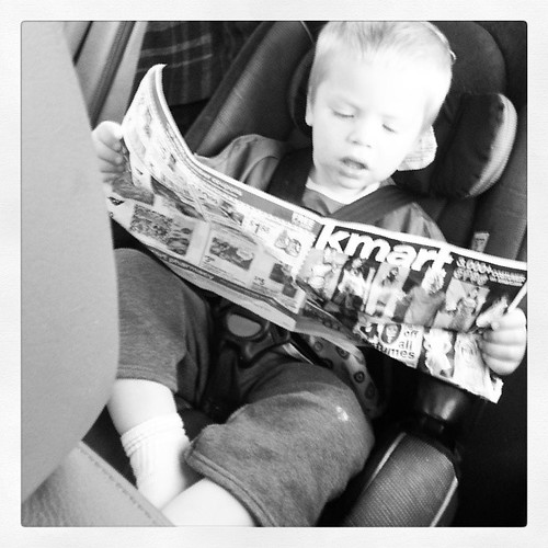 I caught him reading a paper insert.  My word he's toooo cute for his own good! by jonathanandcari