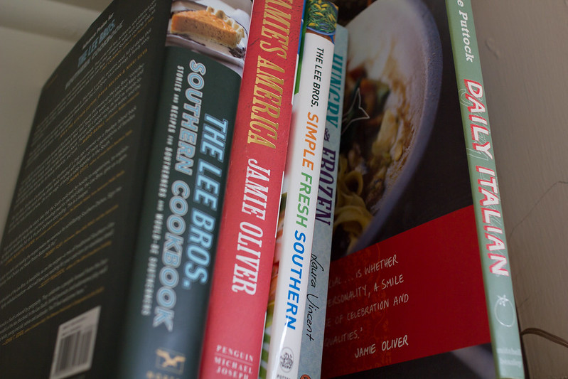 Monday, December 16: Hungry & Frozen hiding amongst the cookbooks from places far far away.