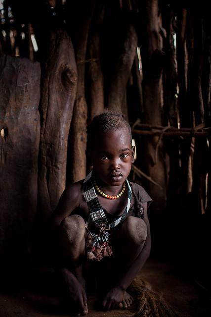 child tribe Hamer inside the hut