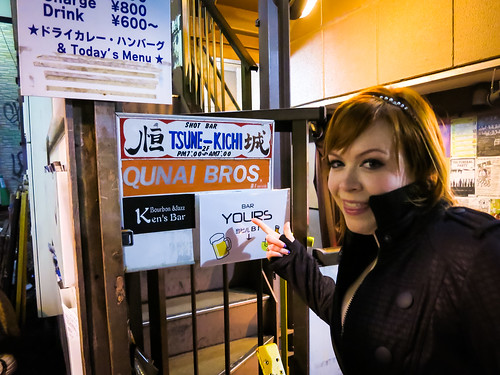 Emily finds the hidden Qunai Bros sign. Tokyo Game Bars