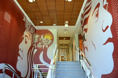 <p>A stairwell in Hale'ōlelo, the new home of the University of Hawai'i at Hilo's Ka Haka 'Ula O Ke'elikōlani College of Hawaiian Language.  On the left is an image of Papa, mother earth, with exerpts from a mele, or song, written in honor of Princess Ruth Ke'elikōlani,  for whom the college is named. The image on the right is of  Wakea, father sky, with exerpts from traditional chants that describe the birthing of the Hawaiian islands.</p>