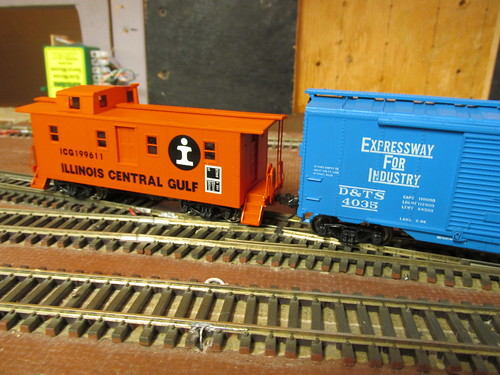 An Illinois Central Gulf Railroad side door caboose brings up the rear. by Eddie from Chicago