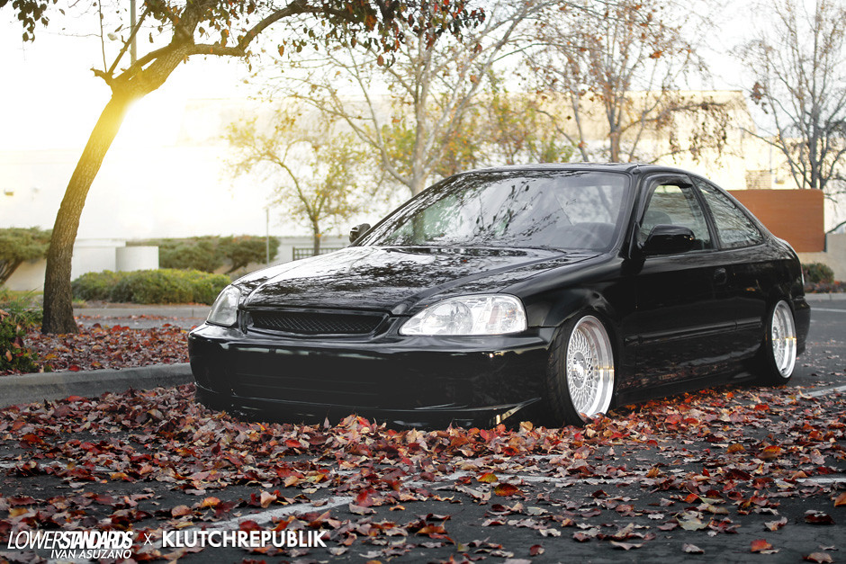 Black Honda civic ek coupe slammed on Klutch wheels Sl1 silver 16x9 with aggressive fitment and stretched tires