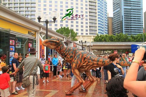 Dinosaur is walking in city