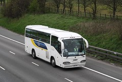 An Irizar Century-bodied Scannia K114 carrying Newcastle United supporters to the Premiership fixture againsy Stoke City.           Location: M6, Cheshire                             14 - 065 01/2004 - new as YN53 OZP. 05/2011 - re-registered UGB 735. ...