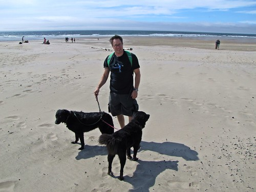 Josh and pets on beach