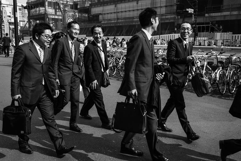 The mood is visibly relaxed during evening time as this group of salarymen head to dinner at Shinjuku.