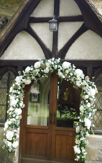 St Peter's church wedding flowers welcome