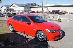 bmw(0.0), sports car(0.0), automobile(1.0), automotive exterior(1.0), executive car(1.0), wheel(1.0), vehicle(1.0), automotive design(1.0), rim(1.0), full-size car(1.0), compact car(1.0), pontiac g8(1.0), sedan(1.0), land vehicle(1.0), luxury vehicle(1.0),
