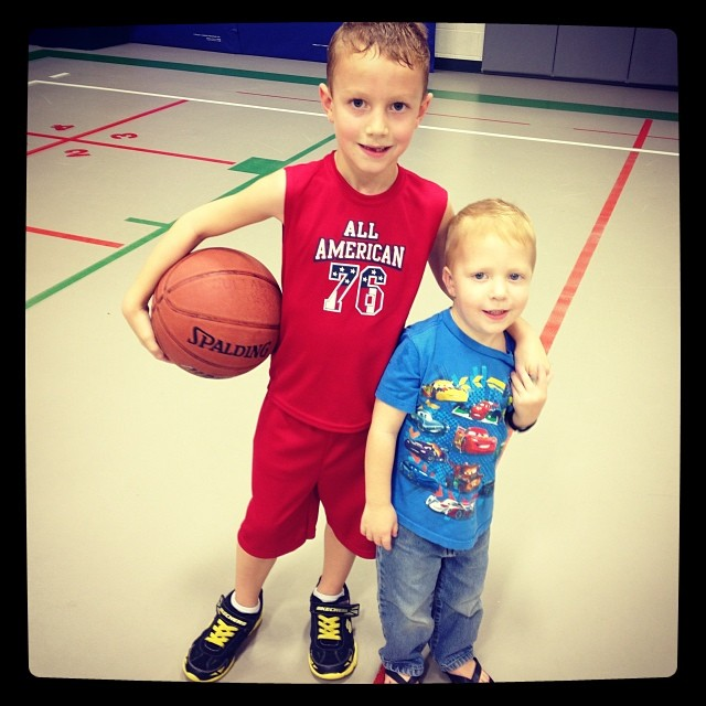 Adam's first basketball practice. (Owen watched in wide eyed wonder and then ran up to his brother as if Adam was Michael Jordan) #brothers