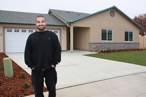 Robert Tapia, a single father of two, is pictured outside the Reedley, Calif. home he proudly helped build with ten other families through USDA's Mutual Self-Help Housing Loan program in partnership with Self-Help Enterprises, which celebrated the completion of its 6,000th home last week. (USDA photo)