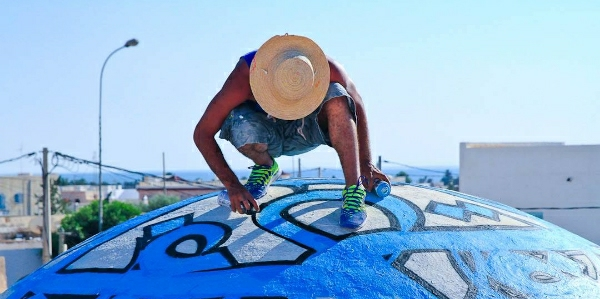 'Calligraffiti' Artist El Seed Makes Tunisia His Canvas
