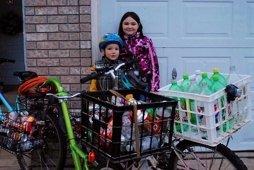 kids with bikes loaded with bottles for returning to recycle