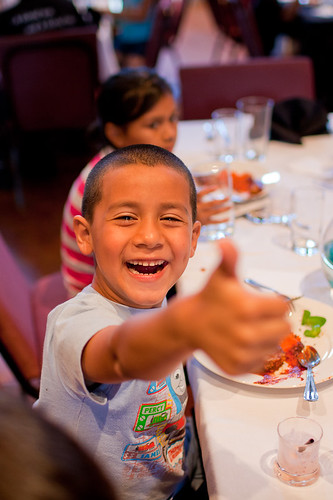 A child at a summer meals site enjoys a tasty and nutritious meal.